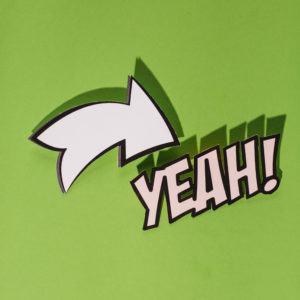yeah-text-with-white-arrow-direction-sign-green-background